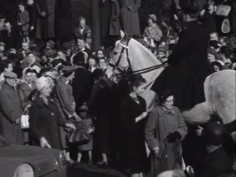 crowds of mourners among the estimated 100 000 attendees gather to pay their respect at the funeral of george formby - merseyside stock videos & royalty-free footage