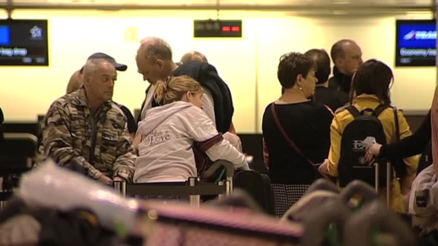 crowds of passengers stranded at heathrow airport wait for information following the closure of european airspace as a result of huge eruption from... - flugpassagier stock-videos und b-roll-filmmaterial