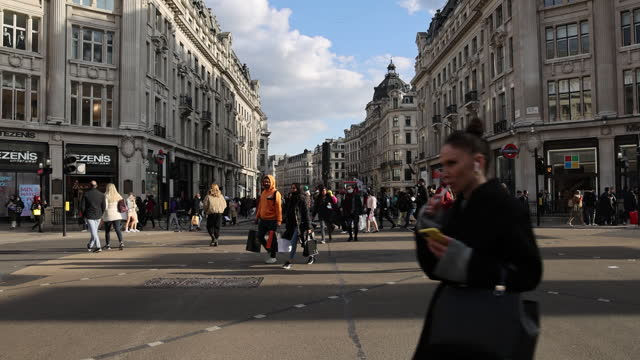 crowds of pedestrians on street as lockdown ended in london, england, uk, on monday, april 12, 2021. - pedestrian crossing stock videos & royalty-free footage