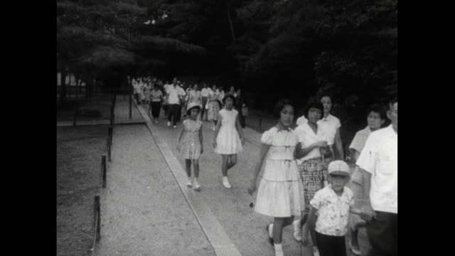 crowds of people arrive at heian shrine in kyoto; 1959 - shinto shrine stock videos & royalty-free footage