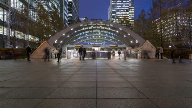 crowds of people at canary wharf underground station at dusk - station stock videos & royalty-free footage
