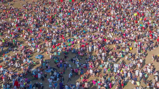 Crowds of people attending music festival, UK.