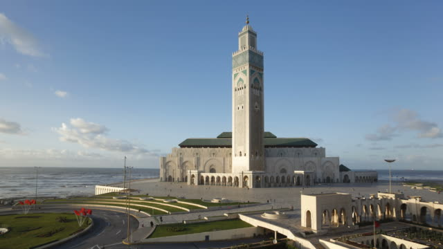 crowds of people come and go from hassan ii mosque. - casablanca morocco stock videos & royalty-free footage