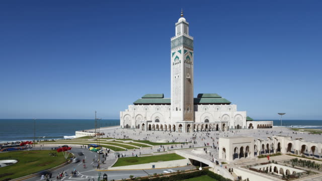 crowds of people come at go at the hassan ii mosque. - casablanca morocco stock videos & royalty-free footage
