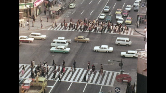 crowds of people crossing the road in tokyo; 1972 - showa period stock videos & royalty-free footage