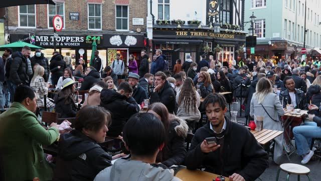 crowds of people enjoy drinks at outdoor bars and restaurants in old compton street, soho on april 16, 2021 in london, united kingdom. pubs and... - outdoors stock videos & royalty-free footage