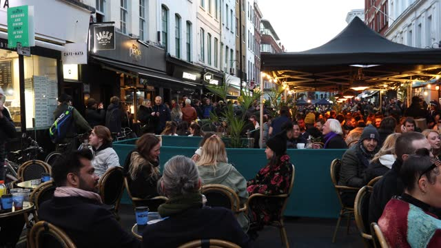 crowds of people enjoy drinks at outdoor bars and restaurants in old compton street, soho on april 16, 2021 in london, united kingdom. pubs and... - mass stock videos & royalty-free footage