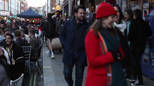 crowds of people enjoy drinks at outdoor bars and restaurants in old compton street, soho on april 16, 2021 in london, united kingdom. pubs and... - crowd stock videos & royalty-free footage