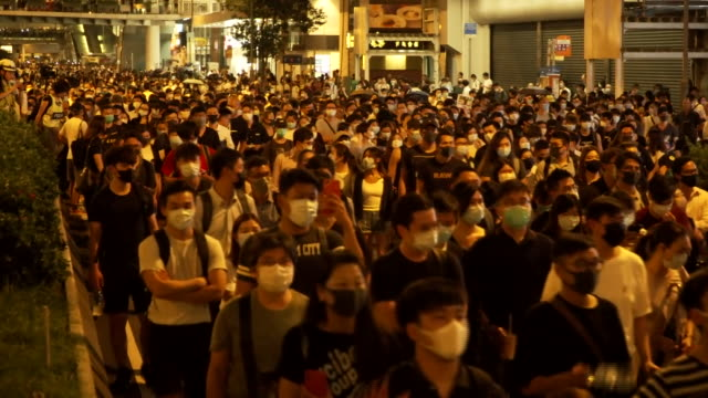crowds of people in hong kong marching against the banning of face masks being worn in public - human face stock videos & royalty-free footage