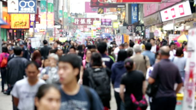 stockvideo's en b-roll-footage met ms slo mo crowds of people in mong kok pedestrian steet / hongkong, china - china oost azië
