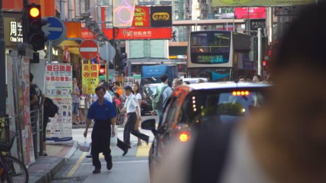 crowds of people in mong kok pedestrian steet - mong kok stock videos & royalty-free footage