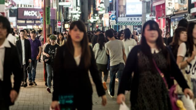 Crowds of people in Shibuya at night
