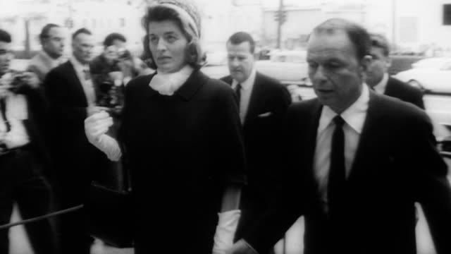 crowds of people line the steps of the church of the good shepherd watching invited guests go inside for gary cooper's funeral / large line of press... - shepherd stock videos & royalty-free footage