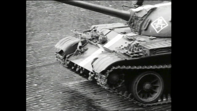 crowds of people marching down wenceslas square with flags toward camera during the soviet invasion of czechoslovakia; tanks parked on the square and... - prague stock videos & royalty-free footage