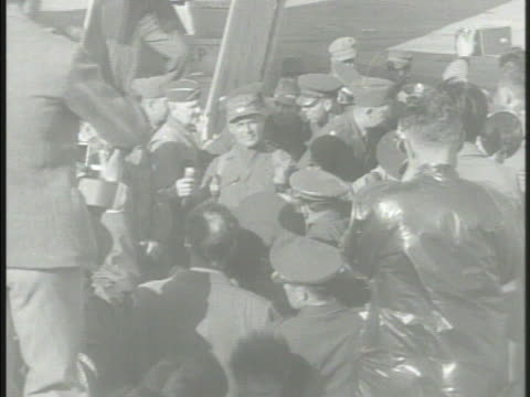 crowds of people officers press photographers crowded around newly appointed commander lieutenantgeneral matthew ridgway on tarmac airport making way... - matthew b. ridgway stock-videos und b-roll-filmmaterial