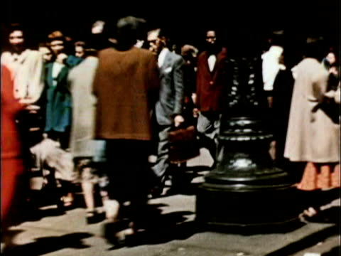 vidéos et rushes de 1956 montage crowds of people on city streets, in stadium stands, crossing busy intersection / usa - 1956