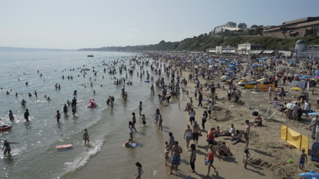crowds of people on the beach. - bournemouth stock-videos und b-roll-filmmaterial