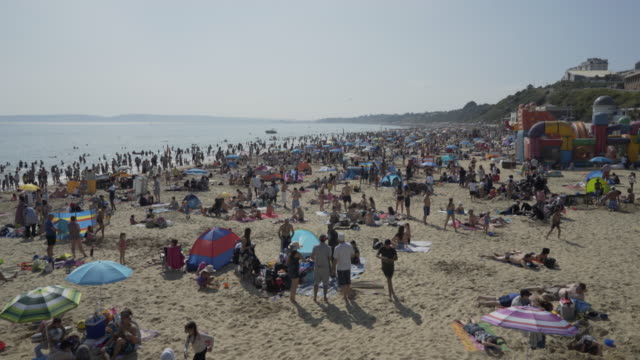 crowds of people on the beach. - bournemouth england stock videos & royalty-free footage