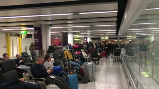 crowds of people queueing for check-in at gatwick airport as flights resumed after they were grounded due to drone activity in restricted airspace - gatwick airport stock videos & royalty-free footage