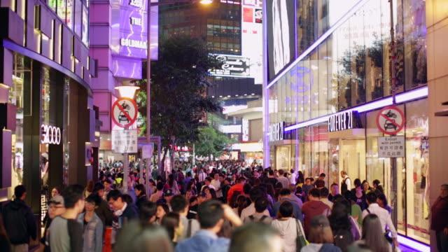 ws crowds of people shopping in causeway bay hong kong island - hong kong island stock videos & royalty-free footage