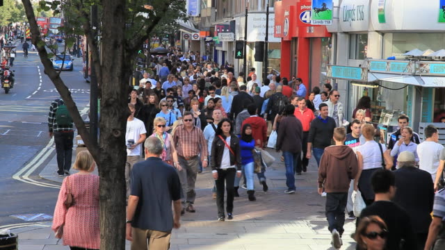 crowds of people shopping in oxford street london. - oxford street stock-videos und b-roll-filmmaterial