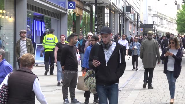 crowds of people wait outside after police avacuated the arndale centre on may 23, 2017 in manchester, england. an explosion occurred at manchester... - 2017 stock videos & royalty-free footage