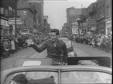crowds of people walk alongside car / people on street throw confetti / sergeant charles 'commando' kelly waves from open limousine in parade in his... - sergeant stock videos & royalty-free footage