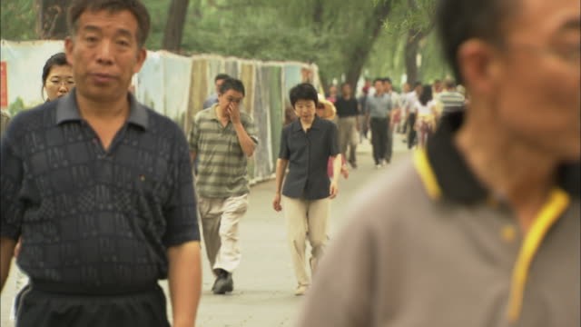 ms selective focus crowds of people walking, beijing, china - pavement video stock e b–roll