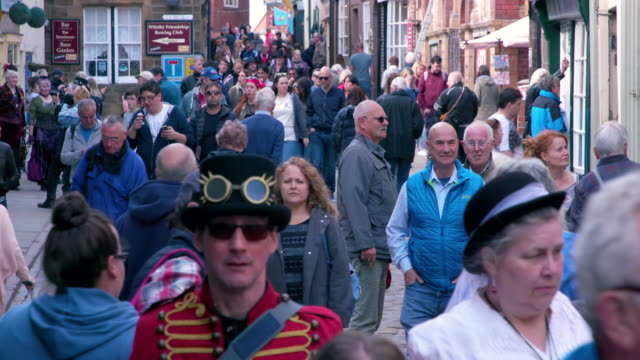 crowds of people walking church street, whitby, north yorkshire, england - tourism stock videos & royalty-free footage