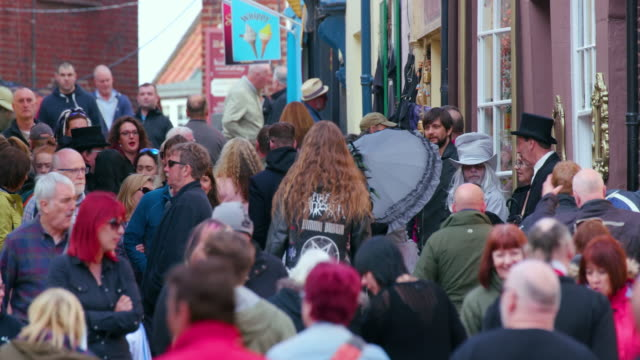 crowds of people walking church street, whitby, north yorkshire, england - whitby north yorkshire england stock videos & royalty-free footage