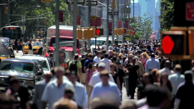 crowds of people walking in midtown of manhattan in new york city - population explosion stock videos & royalty-free footage