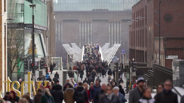 crowds of people walking over the millennium footbridge, london - central london video stock e b–roll