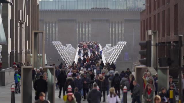 crowds of people walking over the millennium footbridge, london - museum stock videos & royalty-free footage