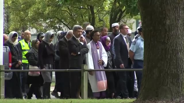 crowds of people walking past the al noor mosque in christchurch - christchurch stock-videos und b-roll-filmmaterial