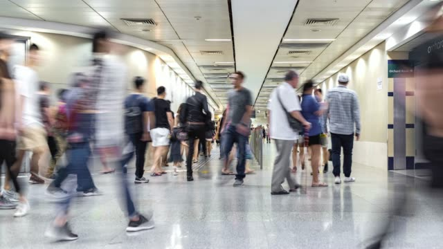 crowds of people walking through a busy underpass subway, leading to train station - generic location stock videos & royalty-free footage