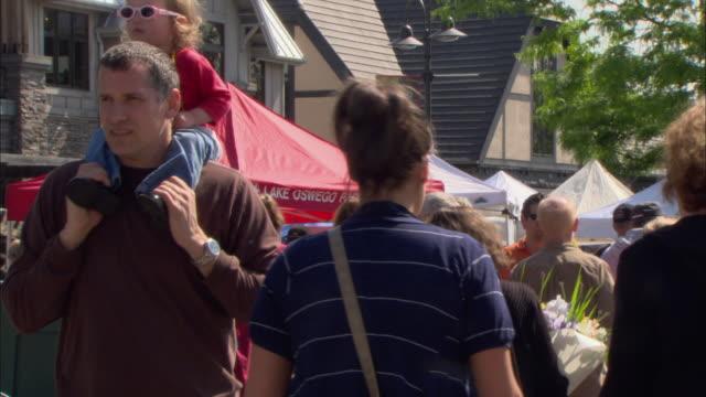 MS Crowds of people walking through farmer's market / Lake Oswego, Oregon, USA