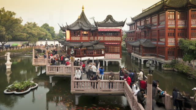 Crowds of people zig-zag along a bridge at Yuyuan Bazaar.