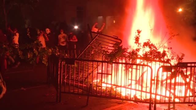 crowds of protesters break curfew in washington to demonstrate near the white house, chanting slogans, lighting fires and waving signs, before being... - protestor stock videos & royalty-free footage