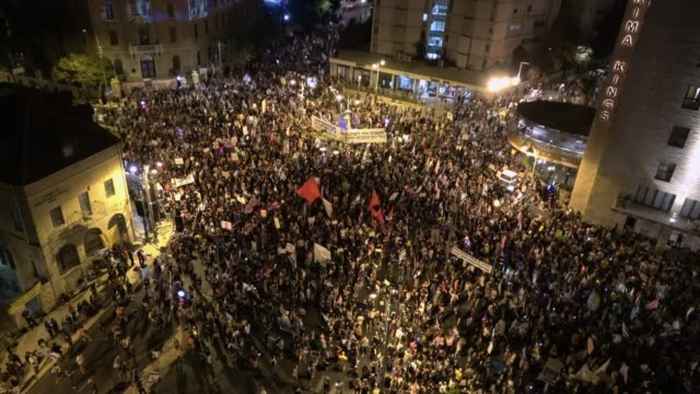 crowds of protesters gather during a mass demonstration attended by over 25000 people near prime minister's official residence as part of ongoing... - jerusalem stock videos & royalty-free footage