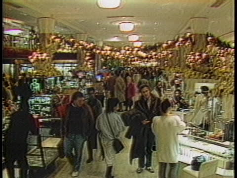 crowds of shoppers enter a store decorated for the holiday season. - department store stock videos & royalty-free footage