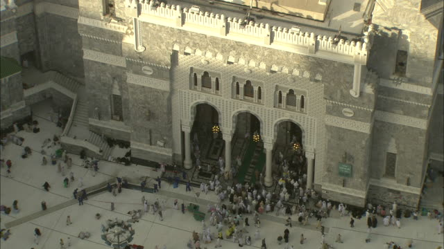 Crowds of the Muslim faithful enter and leave a sacred site in Saudi Arabia.