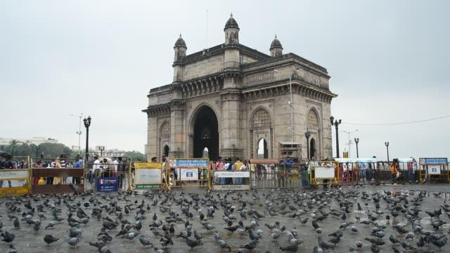 crowds of tourist at the gateway of india, mumbai, maharashtra, india - fence stock videos & royalty-free footage