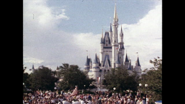 crowds of tourists and visitors at disney world; 1980 - castle stock videos & royalty-free footage