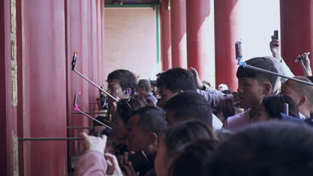 crowds of tourists approach palace museum in forbidden city - beijing stock videos & royalty-free footage