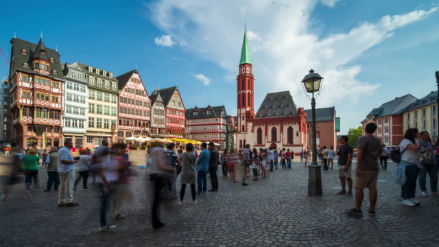 crowds of tourists at the romerberg, frankfurt's old town center - 4k time lapse - old town stock videos & royalty-free footage