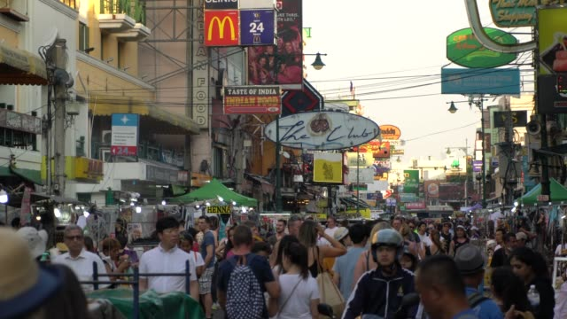 crowds of tourists looking for fun at the the khao san road area  in bangkok, thailand - bangkok stock videos & royalty-free footage