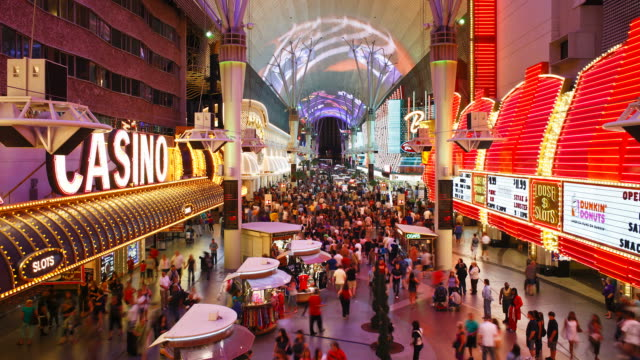 crowds of tourists visit the fremont street experience in las vegas. - the strip las vegas stock videos & royalty-free footage