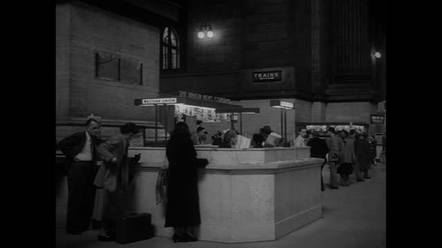 crowds of travelers walk through new york city's penn station. - new york city penn station stock videos & royalty-free footage