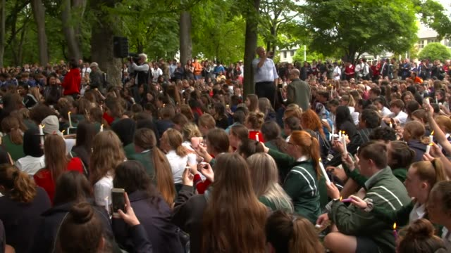 crowds of young people at a vigil to commemorate victims of the christchurch terrorist attack - christchurch stock-videos und b-roll-filmmaterial