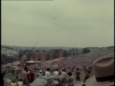 crowds of young people swarm max yasgur's farm in bethel new york for the 1969 woodstock music and art fair - music or celebrities or fashion or film industry or film premiere or youth culture or novelty item or vacations stock-videos und b-roll-filmmaterial